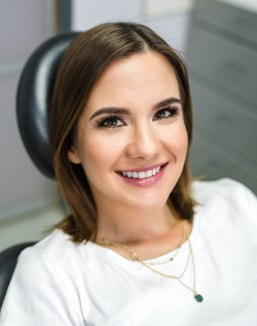 Woman smiling during preventive dentistry visit
