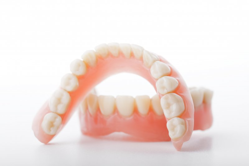an up-close view of a set of full dentures designed for a patient with an upper and lower row of missing teeth